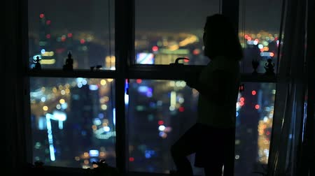 apartamentos : women drinking and watch aerial night city at luxury home
