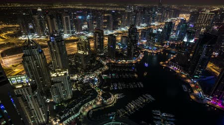 Объединенные Арабские Эмираты : time lapse photography, Ultra HD 4K aerial view Sheikh Zayed Road with Dubai Marina in United Arab Emirates at night, Photo Sequence shot in RAW