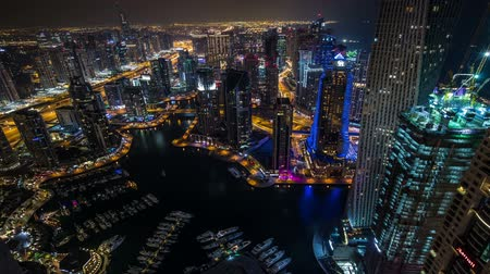 birleşik arap emirlikleri : time lapse photography, aerial view Sheikh Zayed Road with Dubai Marina in United Arab Emirates at night, Photo Sequence shot in RAW Stok Video