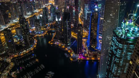time lapse photography, Ultra HD 4K aerial view Sheikh Zayed Road with Dubai Marina in United Arab Emirates at night, Photo Sequence shot in RAW, tilt