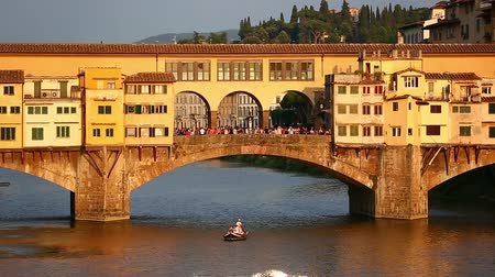 toscana : Gondola Trip Sunset Ponte Vecchio Bridge on Arno River at Florence Tuscany Italy Stock Footage