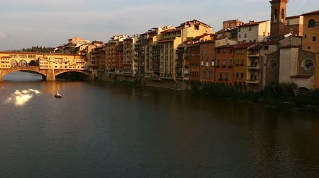 toscana : Gondola Trip and Ponte Vecchio Bridge on Arno River at Florence Tuscany Italy