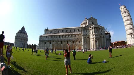 toscana : Pan Shot Tourist Visiting Famous Place Pisa Tower at Square of Miracles Torre di Pisa at Piazza dei Miracoli at Tuscany Italy