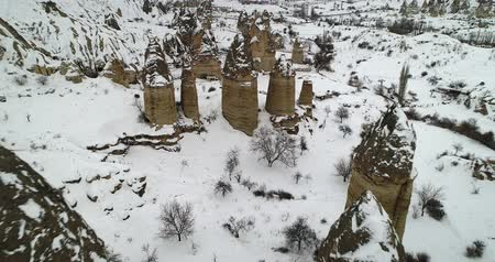formasyonlar : 4K aerial view fairy chimney winter season of Cappadocia Turkey Stok Video