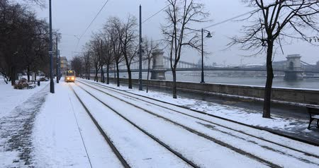 Budapest, Hungary, March 15 jan 2019 Old yellow Tram and chain bridge at winter Stock mozgókép