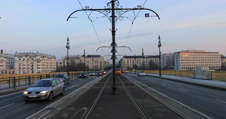 Budapest, Hungary, March 15 jan 2019 Old yellow tram and city traffic at winter. Time lapse Wideo