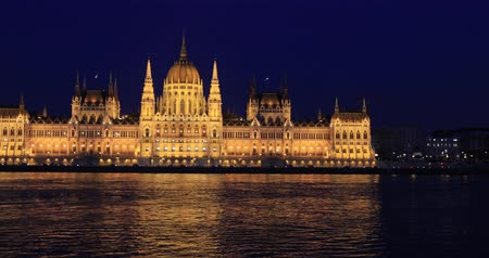 Old Hungarian Parliament building at night. Stock mozgókép