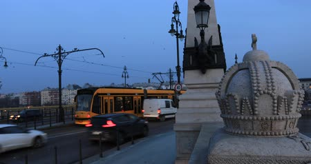 Budapest, Hungary, March 15 jan 2019 Old yellow Tram passing Margaret bridge at winter time