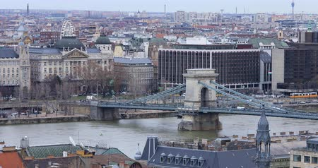 BUDAPEST, HUNGARY - JANUARY 17, 2019: A view of the buildings, the Danube river and the Old Town in Budapest. City traffic time lapse