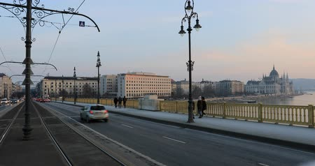 Budapest, Hungary, March 15 jan 2019 Old yellow Tram and famous Margaret bridge at winter. Time lapse