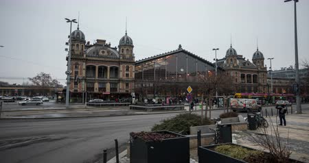 railwayman : Nyugati Train Station in Budapest. City traffic time lapse