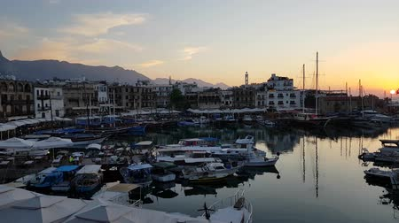 senhor : A view of Kyrenia harbor at sunset time Vídeos
