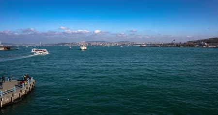 senhor : ISTANBUL, TURKEY- JANUARY 7, 2019: Passenger ships and boats cruising over Bosporus at sunny spring day. Time lapse