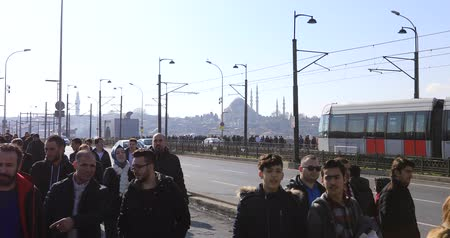 cami : Many People Walking on the Galata Bridge and Istanbul city traffic. Time lapse. Galata bridge connect from Karakoy district to Eminonu district.