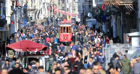 busy line : A view of the crowded walk on famous Taksim Istiklal Avenue at winter time. Time lapse Stock Footage