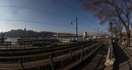 railwayman : Old yellow tram and city traffic at winter. Time lapse