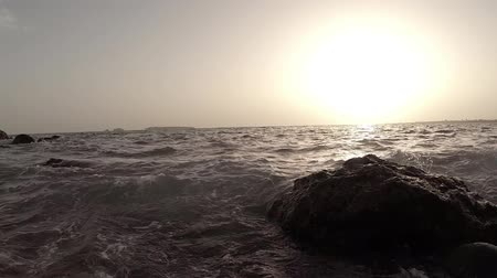 pobřežní : The beautiful shores of the Atlantic ocean with its rocky coastline and gentle waves near the City of Dakar in Senegal