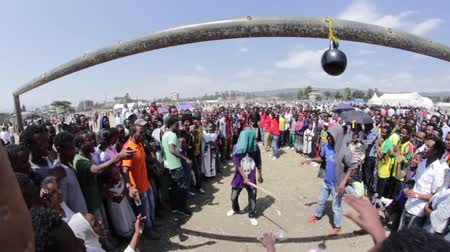 janeiro : ADDIS ABABA, ETHIOPIA - JANUARY 19: A group of young people organise unofficial carnival likes games of chance and skill during Timket celebrations of Epiphany, on January 19, 2014 in Addis Ababa.