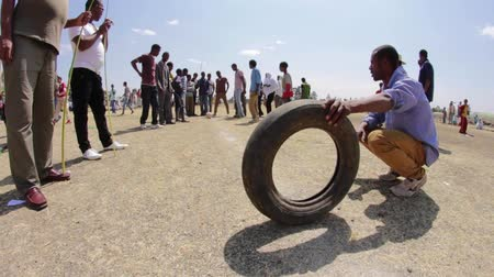 epiphany : ADDIS ABABA, ETHIOPIA - JANUARY 19: A group of young people organise unofficial carnival likes games of chance and skill during Timket celebration of Epiphany, on January 19, 2014 in Addis Ababa.