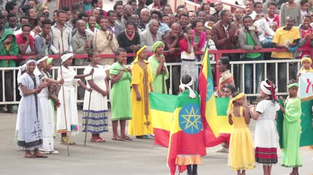 Addis Ababa  May 5: Young children dressed in colourful traditional outfit perform in front of the Ethiopian President at the 74th anniversary of Patriots Victory day commemorating the defeat of the invading Italians on May 5 2015 in Addis Ababa Ethiopia