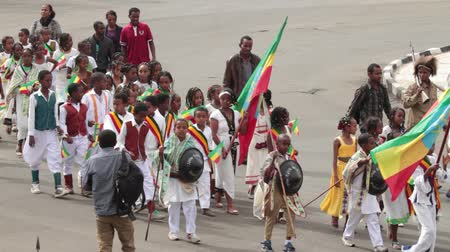 Addis Ababa  May 5: Young children dressed in colourful traditional outfit march at the 74th anniversary of Patriots Victory day commemorating the defeat of the invading Italians on May 5 2015 in Addis Ababa Ethiopia.