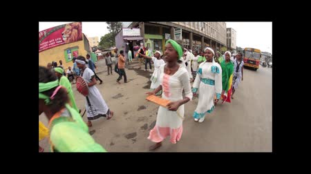Addis Ababa  May 5: Young men and women dressed in colourful traditional outfit march on the streets of Addis Ababa during the 74th anniversary of Patriots Victory day commemorating the defeat of the invading Italians on May 5 2015 in Addis Ababa Ethiopi