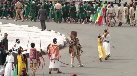 Addis Ababa - May 5: A young girl dressed in colourful traditional outfit holding a spear and shield marches at the 74th anniversary of Patriots Victory day commemorating the defeat of the invading Italians on May 5, 2015 in Addis Ababa, Ethiopia.