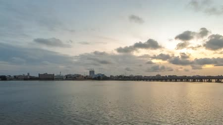 Time-lapse video of the sun setting over a bridge in Cotonou, Benin