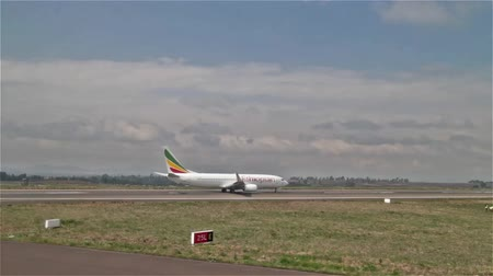 Addis Ababa, Ethiopia - June 22: An Ethiopian Airlines flight about to take off on the runway at Bole International Airport on June 22, 2015 at Addis Ababa, Ethiopia Стоковые видеозаписи