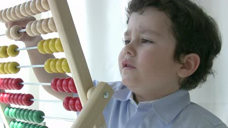 abacus : Preschool student learning  mathematics with abacus
