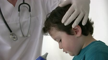 male : Pediatrician checking Little boy Stock Footage