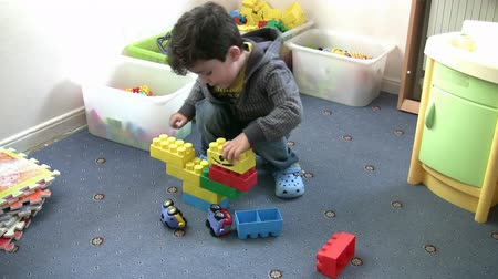 przedszkole : Little Boy playing toys in the kindergarten Wideo
