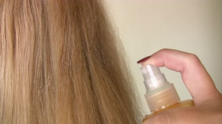 curling hair : Woman applying hair lotion