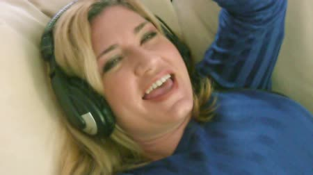 leisureactivity : Woman listening to music with headphones