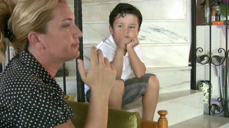 cigarettes : Little boy looking at his mother while smoking cigarette