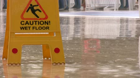Пол : Caution wet floor, yellow sign by the pool