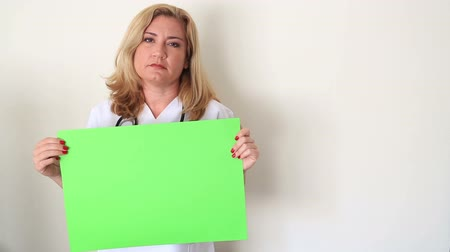 holding onto : Sad Woman Holding Onto A Green Screen