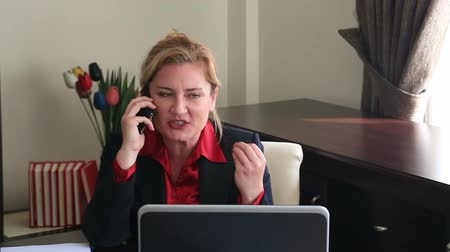 komoly : Nervous businesswoman talking on the phone