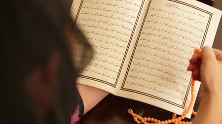 dua eden : Muslim woman praying and reading koran