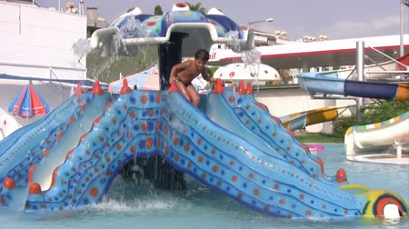 slayt : Child having fun at water park
