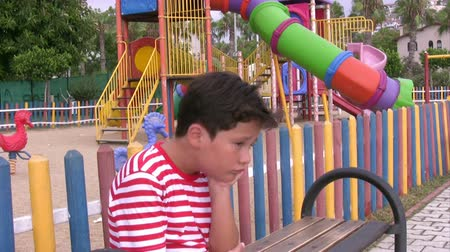 lonely : Sad child in the playground Stock Footage