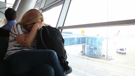 yorgunluk : Tired woman sleeping  on the airport, waiting for her flight Stok Video