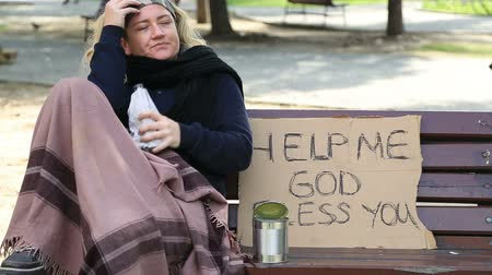 pleading : Homeless alcoholic woman drinking wine