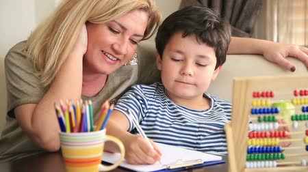 домашнее задание : Little student doing homework with his mother