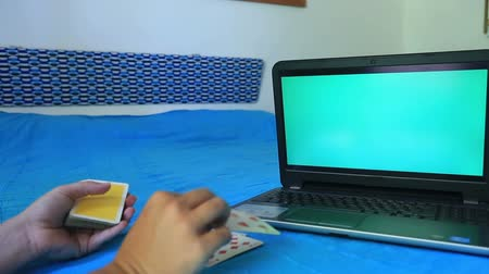 foretell : Green screen monitor and playing  card