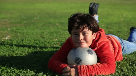 sport dzieci : Portrait of a  happy child with a ball smiling to a camera