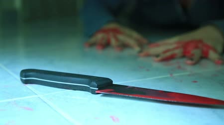 robbed : Woman hand holding knife with blood Stock Footage