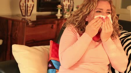 bleeding nose : Portrait of a  worried sick woman with bleeding nose Stock Footage