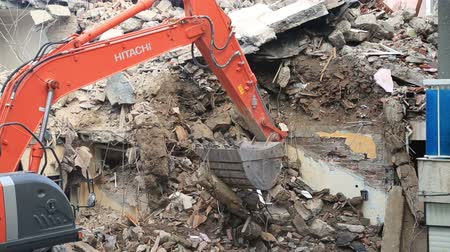 destroyed building : House demolition with bulldozer Stock Footage