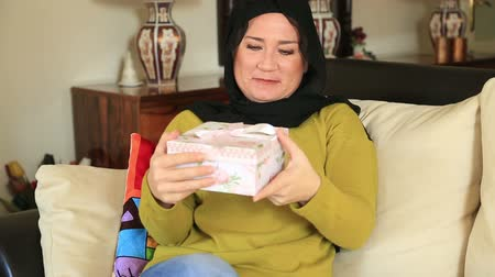 exiting : Portrait of beautiful excited muslim woman holding gift box